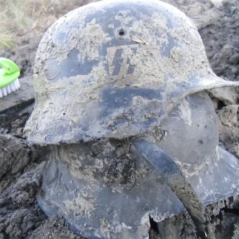 Relic of World War II excavated with a metal detector.