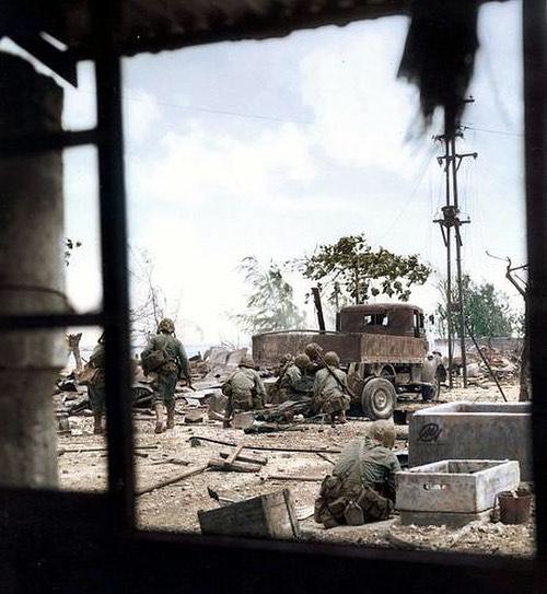 US Marines firing at Japanese soldiers hiding behind debris